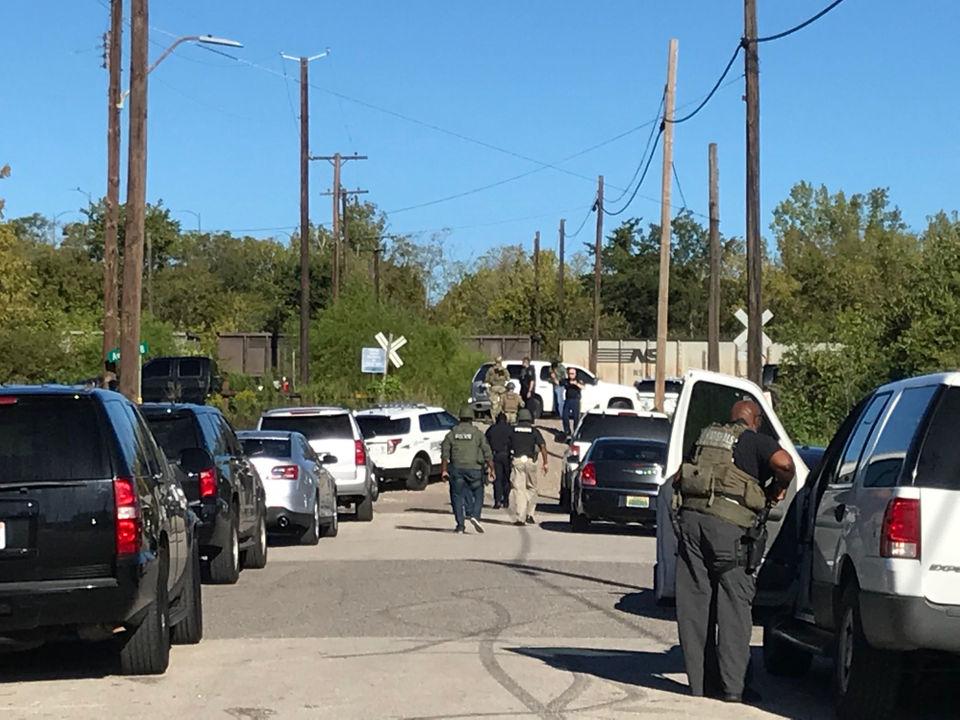 Organized manhunt searching near train tracks