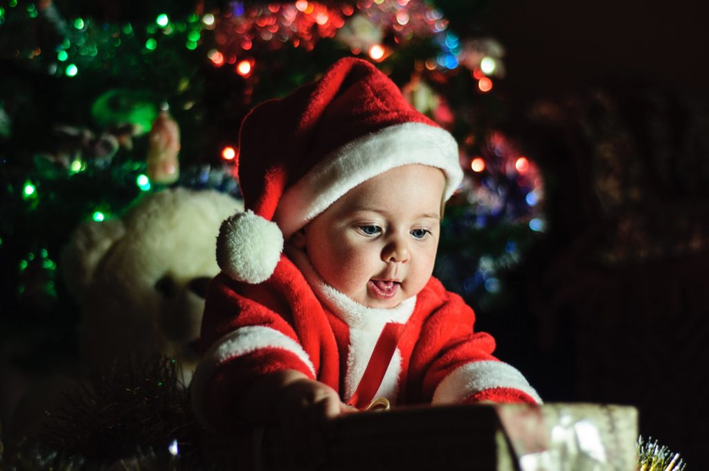 Baby looking at gift